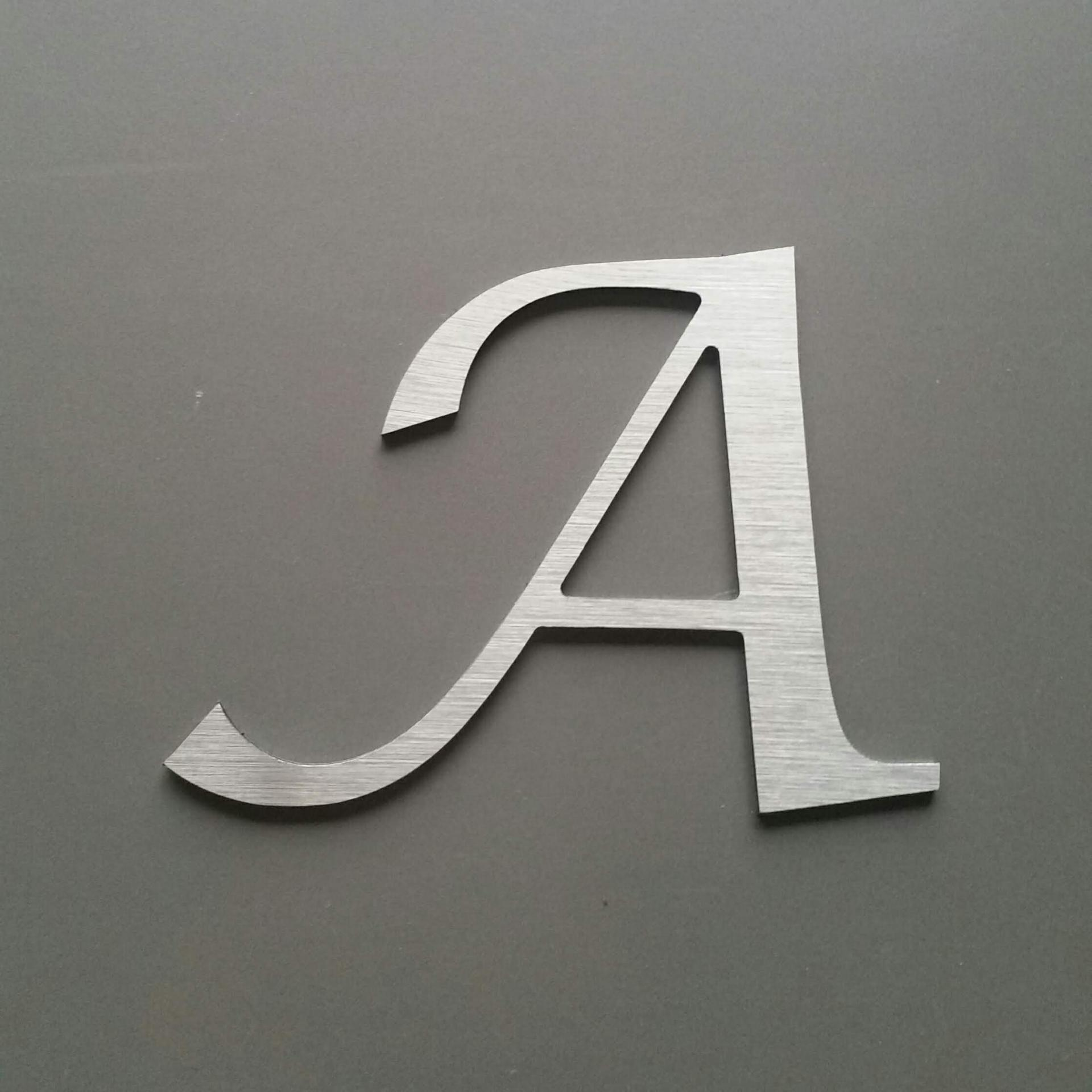 Lettre metal lucida calligraphy
